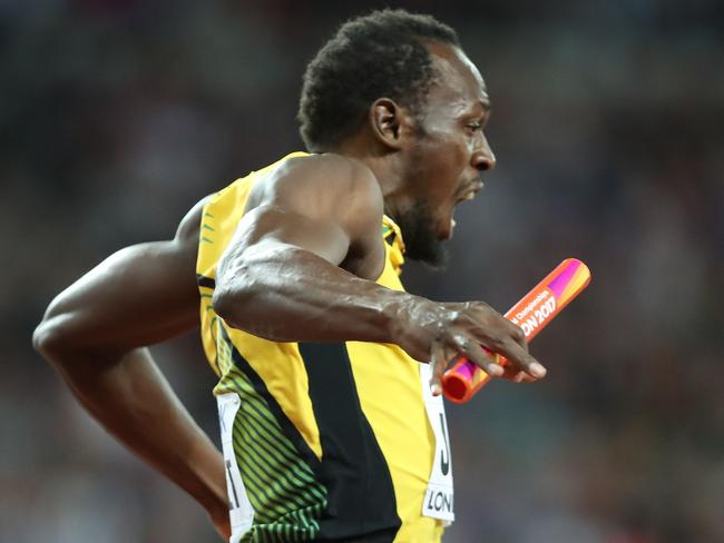Oh, no: The moment Usain Bolt knew something was wrong. Picture: AFP
