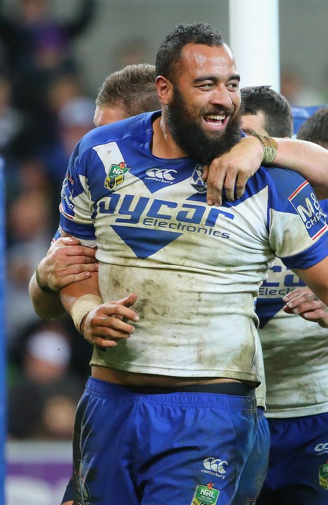 Sam Kasiano of the Bulldogs celebrates after scoring a try.