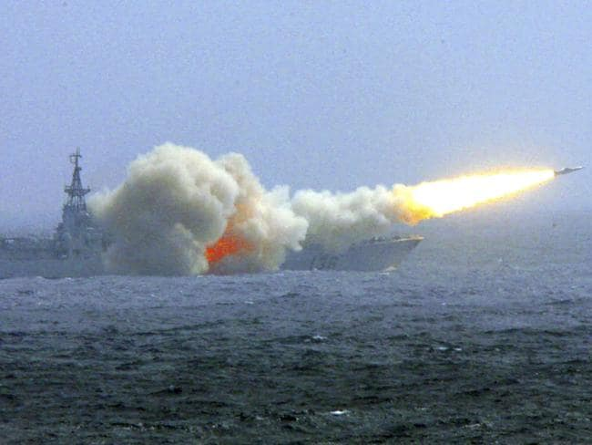 A destroyer of the South China Sea Fleet fires a missile during a training exercise. Picture: AP / Xinhua