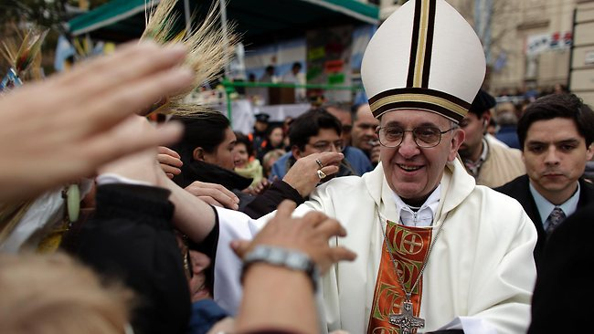 Cardinal Jorge Bergoglio, now Pope Francis I, gives a mass outside San Cayetano church in Buenos Aires.