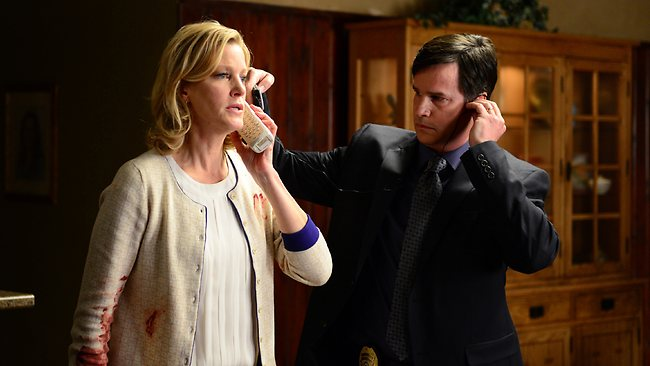 A bloodied Anna Gunn as Skyler White takes a chilling phone call from Heisenberg as cops listen in, on the nail-biting final season of  <em>Breaking Bad.</em> Picture: AP/AMC