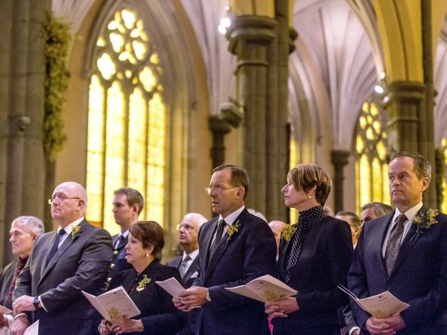 Respects ... Governor-General Sir Peter Cosgrove (second left), Prime Minister Tony Abbott (centre) and opposition leader Bill Shorten (right) attend a national memorial service for MH17 victims. Picture: Mark Dadswell