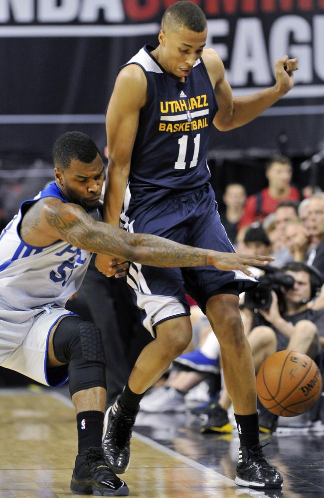 Dante Exum shields a loose ball from the Philadelphia 76ers' Sean Kilpatrick in Las Vegas.