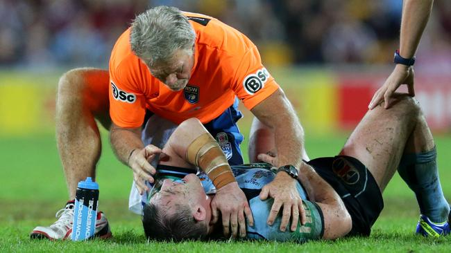 Paul Gallen down injured in Origin II. Picture: Darren England