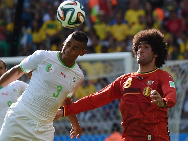 Marouane Fellaini (right) scored Belgium's equaliser against Algeria in Goup H of the World Cup.