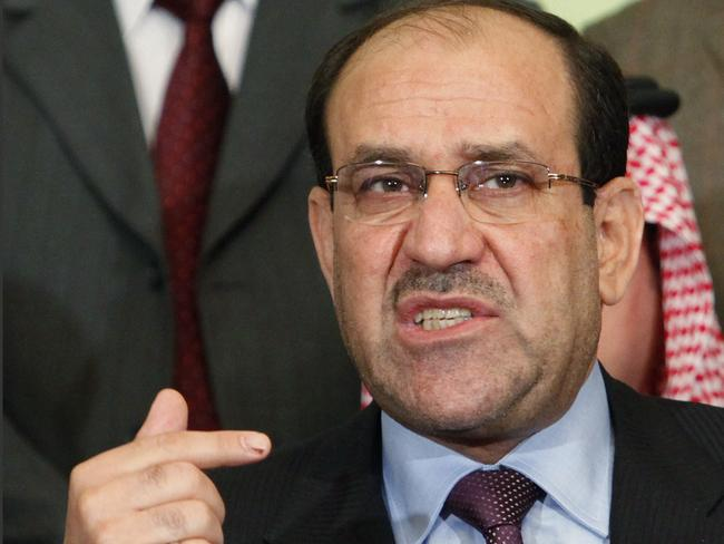 Won't back down ... Iraqi Prime Minister Nouri al-Maliki speaks to the press in Baghdad, Iraq.