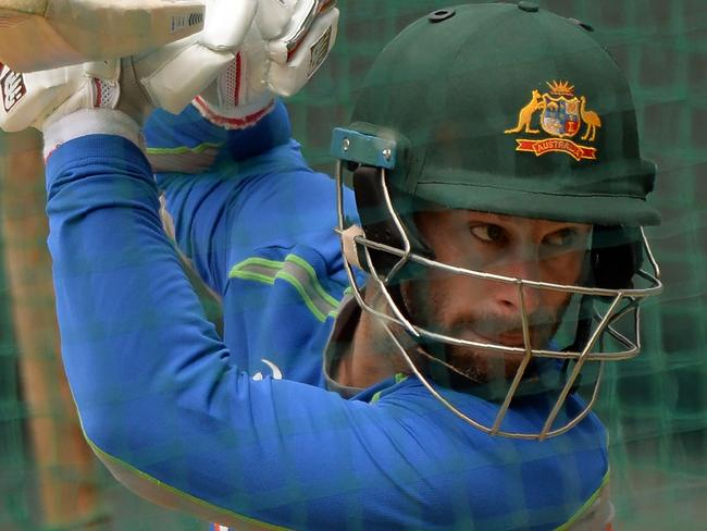 Australian cricketer Matthew Wade bats during a training session at the Holkar Stadium in Indore on September 23, 2017. Australia will play the third one-day international cricket match against India on September 24 in Indore. / AFP PHOTO / PUNIT PARANJPE / ----IMAGE RESTRICTED TO EDITORIAL USE - STRICTLY NO COMMERCIAL USE----- / GETTYOUT