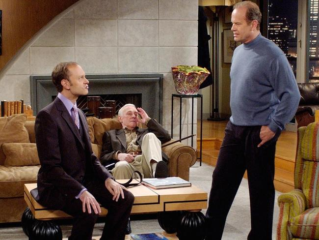 Kelsey Grammer as Dr. Frasier Crane talks with co-stars David Hyde Pierce as his brother Niles and John Mahoney during filming of the final episode.