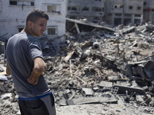 All gone ... a Palestinian inspects a destroyed house in the heavily bombed Gaza City neighbourhood of Shijaiyah, close to the Israeli border. Picture: Dusan Vranic / AP PHOTO