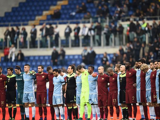 Players and referees stand together to pay tribute to Brazilian football team Chapecoense which was wiped out in the crash. Picture: Filippo Monteforte/AFP