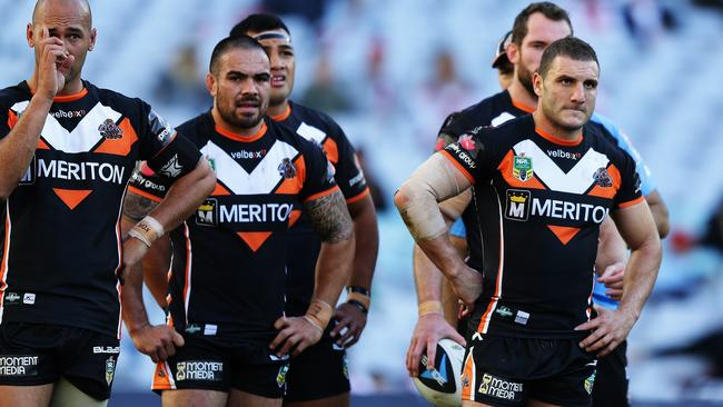 Tigers players show their disappointment after losing to the Dragons. Pic: Brett Costello
