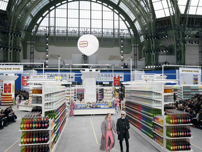 Chanel in aisle two...German fashion designer Karl Lagerfeld, flanked by British model Ca