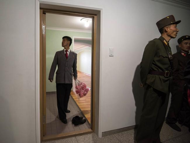 A man inspects an apartment on the 70th floor of an apartment building which is an avenue from the mausoleum where Kim Jong-un's grandfather Kim Il-sung and father Kim Jong-Ii lie in state. Picture: Ed Jones/AFP