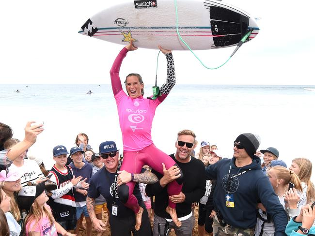 Courtney Conlogue chaired up the beach following her win over Stephanie Gilmore.