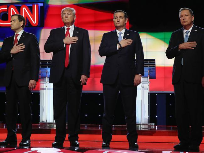Then Republican presidential candidates, Sen. Marco Rubio, Donald Trump, Sen. Ted Cruz, and Ohio Gov. John Kasich listen to the national anthem before the start of a debate. Picture: Getty