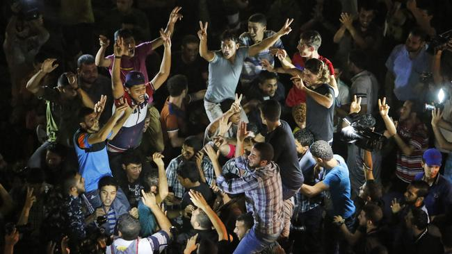 Israeli soldier captured ... Palestinians chant slogans during celebrations outside the Shifa hospital in Gaza City. Picture: Lefteris Pitarakis