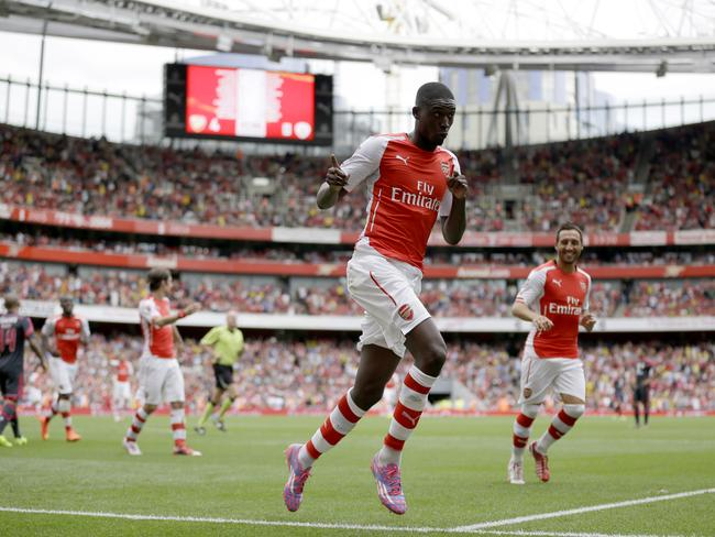 Arsenal's Yaya Sanogo celebrates scoring his fourth goal during the Emirates Cup match against Benfica.