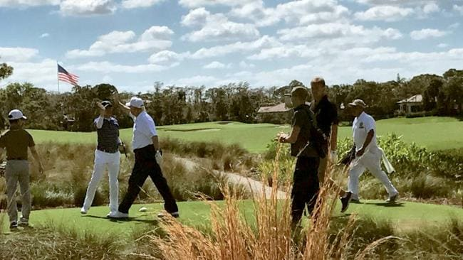 Presidential business: US President Donald Trump high-fives visiting Japanese Prime Minister Shinzo Abe during a round of golf at Trump National Golf Club in Jupiter, Florida earlier this year. Picture: Supplied from Trump's Twitter account