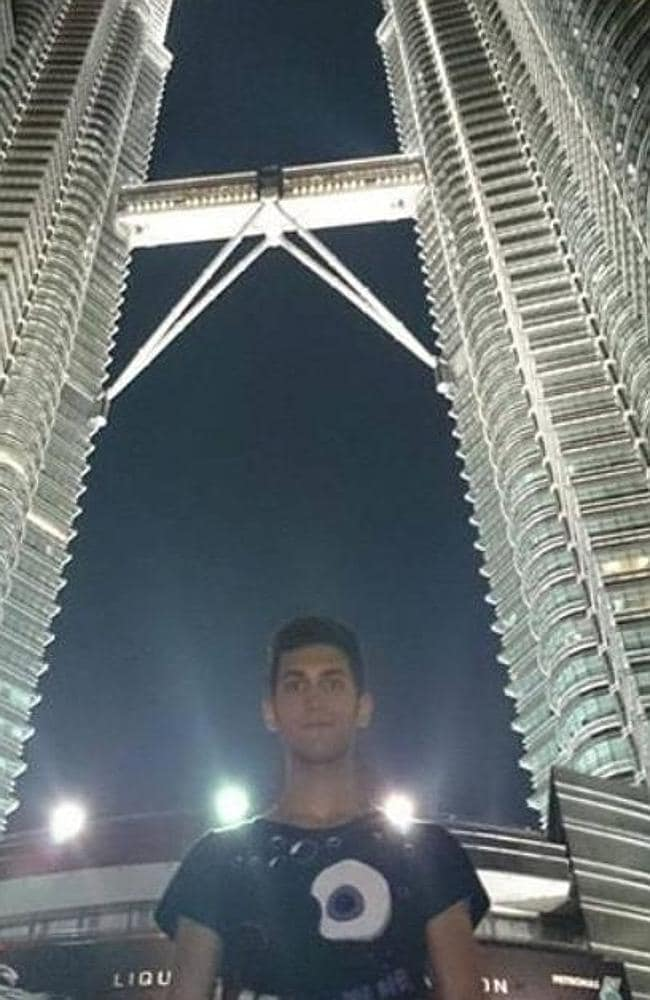 Pouria Nour Mohammad Mehrdad pictured in front of The Petronas Towers, in Kuala Lumpur taken days before his flight. Picture: Facebook