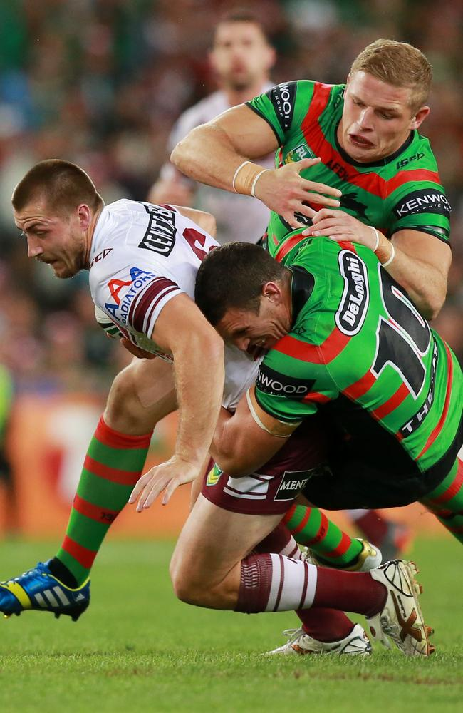Kieran Foran tackled by the Burgess brothers.