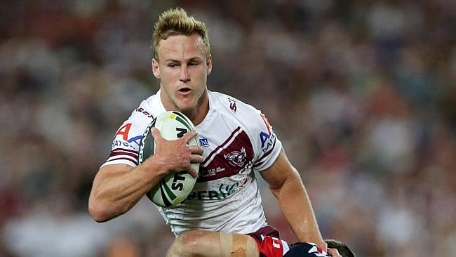 Manly star Daly Cherry-Evans attempts to bust a tackle.