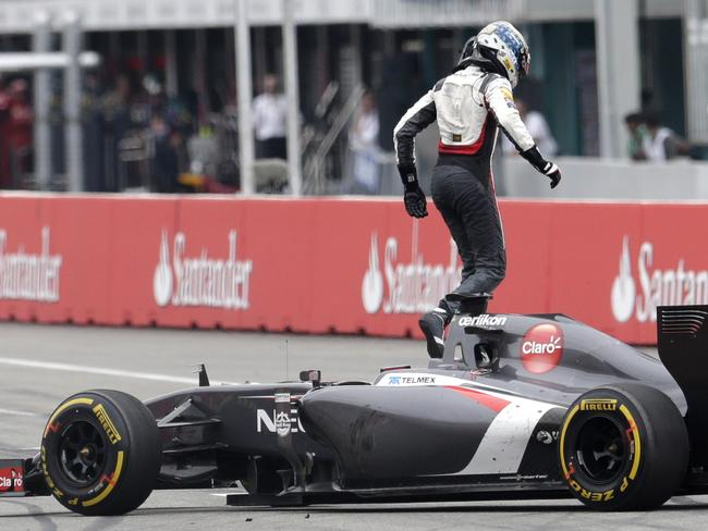 Sauber driver Adrian Sutil of Germany leaves his car after crashing out of the German Grand Prix.
