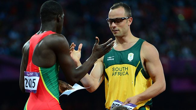 Olympic spirit ... Pistorius swaps his name plate with Grenada's Kirani James.