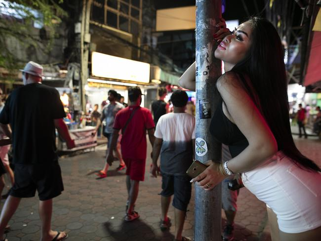 A bar girl draws attention on Walking Street. Picture: Paula Bronstein/Getty Images