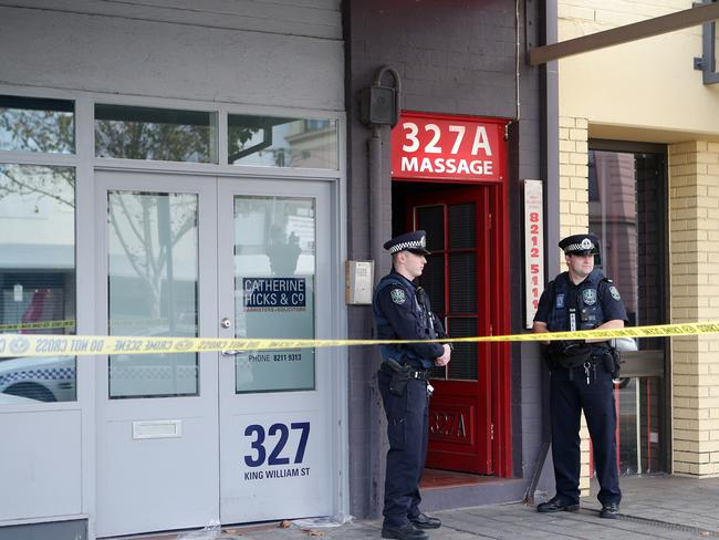 Police guard the siege scene — Marilyn's Studio. Picture: SARAH REED.