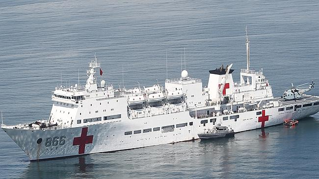 Mixed messages ... Chinese People's Liberation Army hospital ship, the Peace Ark, is anchored off Leyte Gulf, central Philippines, to take part in rehabilitation efforts for typhoon-ravaged areas. (AP /Ver Noveno)