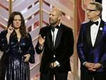 Melissa McCarthy, Jason Statham and Paul Feig speak onstage during the 73rd Annual Golden Globe Awards at The Beverly Hilton Hotel on January 10, 2016 in Beverly Hills, California. (Photo by Paul Drinkwater/NBCUniversal via Getty Images)