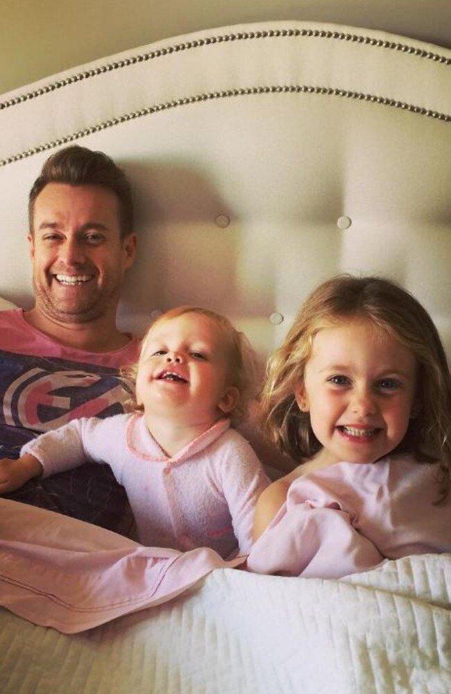 Grant recovering at home with his daughters. Picture: Grant Denyer/Instagram.