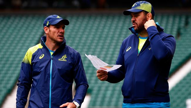 (L-R) Wallabies defensive coach Nathan Grey and head coach Michael Cheika.