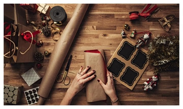 How to wrap a Christmas gift in just 30 seconds - with three pieces of tape