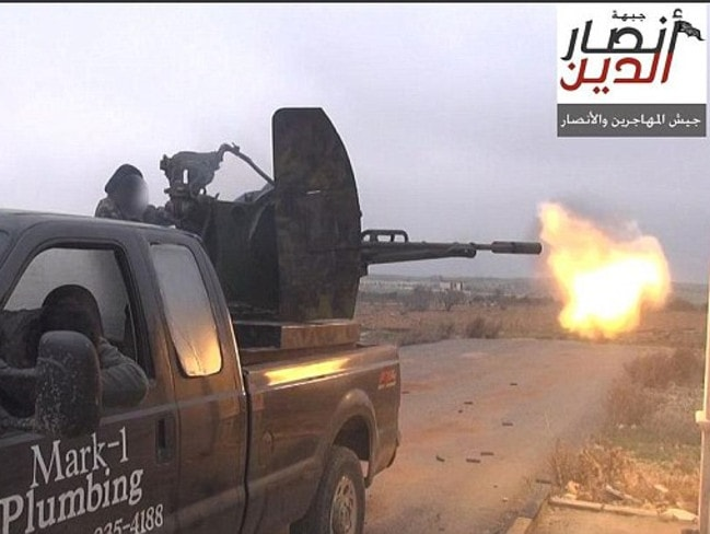 Texas plumber's pick-up truck ... Mark Oberholtzer says his staff have been threatened since his former vehicle was being used by the extremist Ansar al-Deen Front from the front lines of the war in Syria. Picture: Twitter