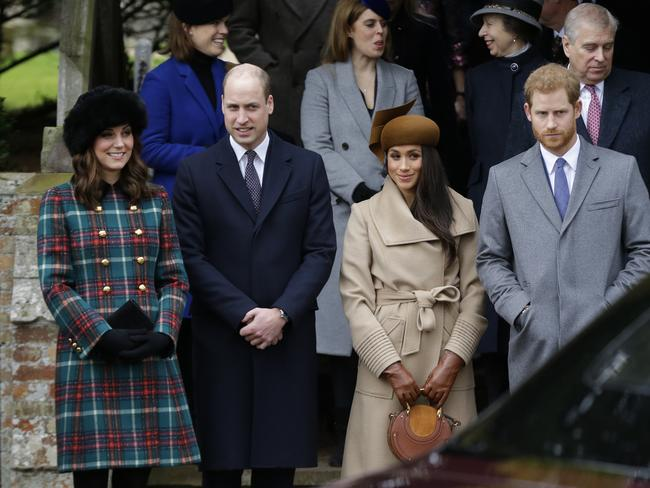 Kate, Duchess of Cambridge, left, with Prince William, Meghan Markle and Prince Harry wait as the Queen leaves by car following the traditional Christmas Day church service. Picture: AP