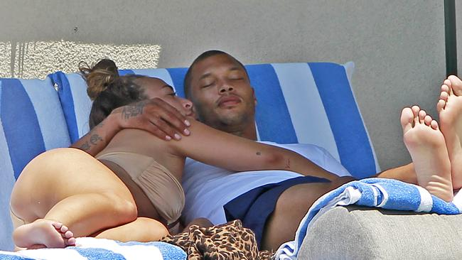 Jeremy Meeks and Chloe Green lounge around the poolside in Los Angeles. Picture: Splash News