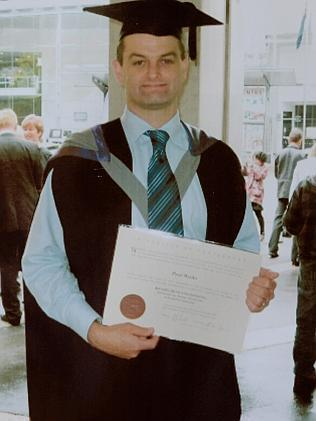 Missing ... Paul Weeks on graduati0n day with a bachelor of engineering.
