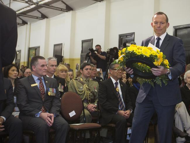 Prime Minister Tony Abbott ... lays a wreath while attending the 70th Anniversary of Victory in the Pacific Commemorative Service at ANZAC House Drill Hall, Adelaide. Picture: AAP