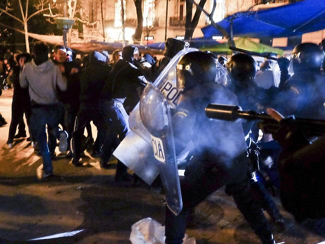 Demonstrators clash ... with anti-riot policemen at the end of the march. Picture: Pedro