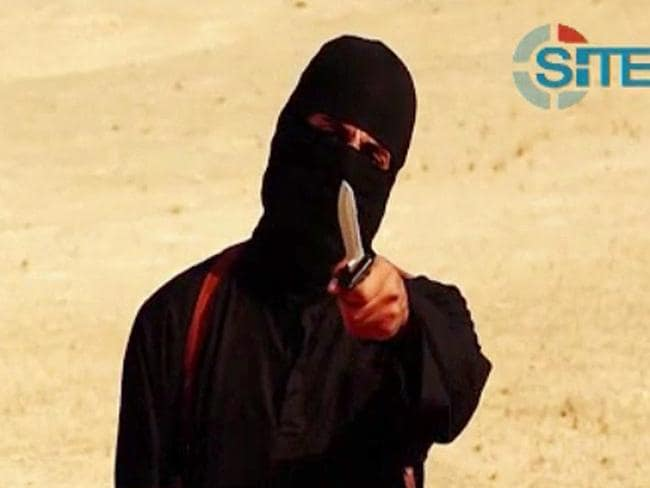 New horror ... a new video released by the Islamic State (IS) and identified by private terrorism monitor SITE Intelligence Group shows a masked militant holding a knife before beheading 31-year-old US freelance writer Steven Sotloff. Picture: AFP PHOTO / SITE INTELLIGENCE GROUP / HO