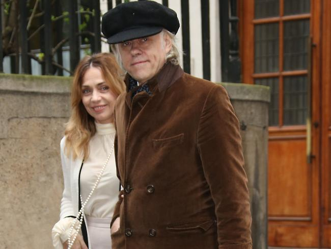 Bob Geldof, right, and Jeanne Marine arrive at St Bride's Church. Picture: Joel Ryan/Invision/AP