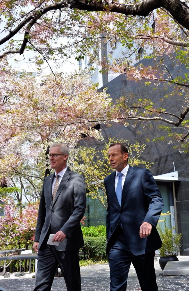 Cherry blossoms ... Prime Minister Tony Abbott, with ambassador Bruce Miller, is on a week-long trade mission.