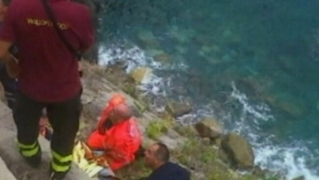 Rescue workers pictured lifting one of the injured from the hiking path in Cinque Terre. Picture: Sky News