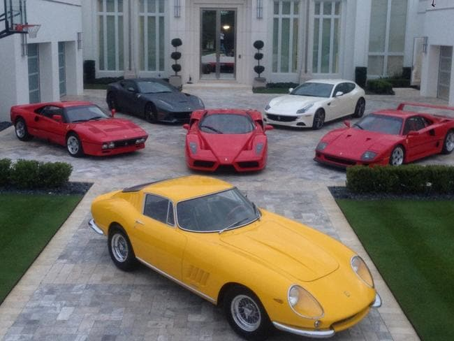 Ian Poulter's Twitter profile pic, complete with six incredibly expensive cars.