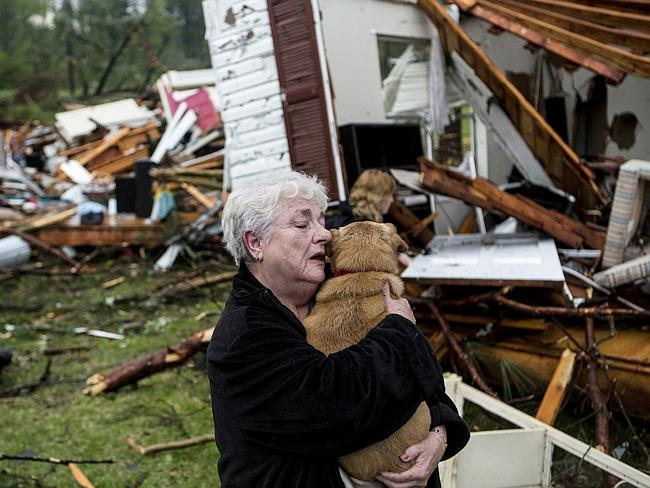 Heartbreak ... Constance Lambert embraces her dog after finding it alive when returning to her destroyed home in Tupelo. AP Photo/The Commercial Appeal, Brad Vest