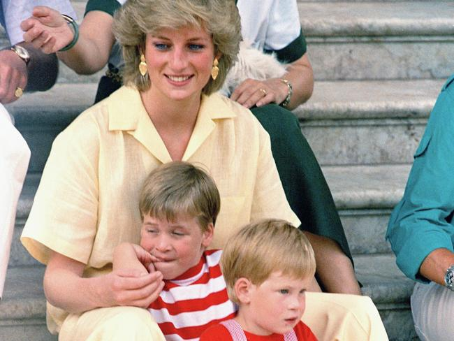 Diana with her sons William and Harry on the island of Mallorca, Spain, in August 1987. Picture: AP