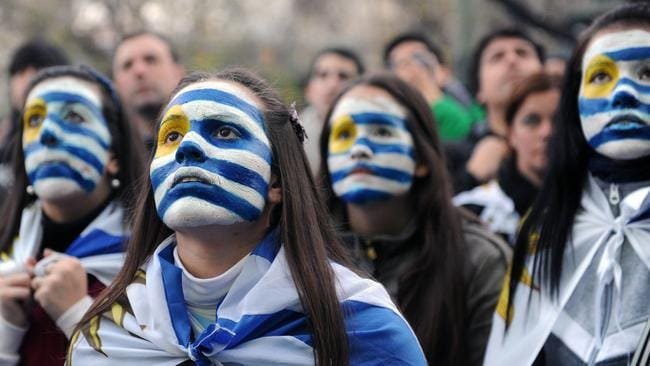 Fans of Uruguay react during the live broadcasting in Montevideo.