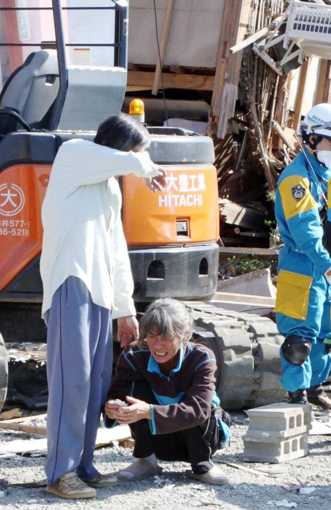 Parents cry as they confirm that their daughter was found dead after an earthquake in Mashiki, Kumamoto prefecture. Picture: Ryota Tajiri/Kyodo News.