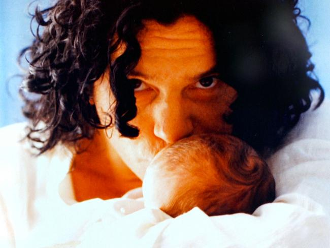 Hutchence with baby daughter Tiger Lily. Picture: Channel Seven